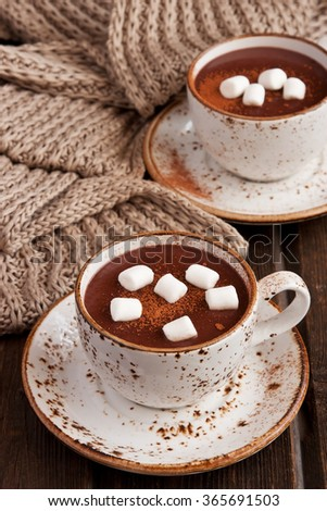 Mug filled with hot chocolate and marshmallows #365691503