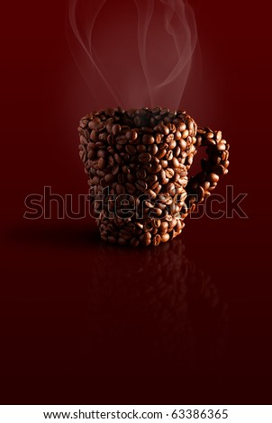 mug in the coffee beans with steam on a brown background