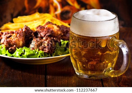 mug of beer and grilled chicken wings