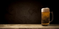 mug of beer on dark background