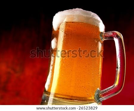 mug of beer on red background