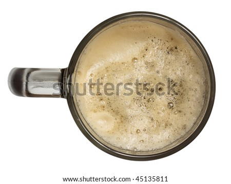 Mug of beer on the white background close-up. View from above.