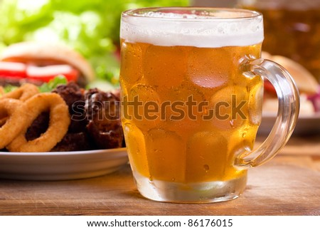 mug of beer with different snack