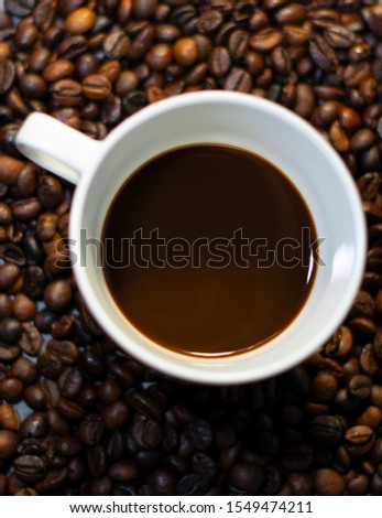 Mug of coffe with coffe beans. #1549474211