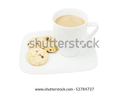 Mug of coffee and cookies on a plate
