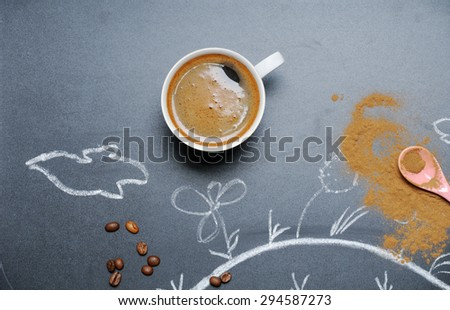 mug of coffee with happy drawing on the blackboard from the top view, happy morning concept