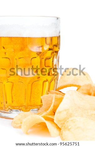 Mug of Fresh beer close-up and Pile of potato chips Isolated on white background