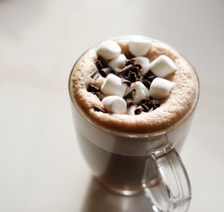 Mug of hot chocolate with marshmallows on table