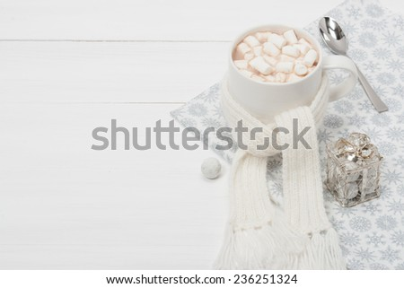 Mug Of Hot Chocolate With Scarf. Marshmallows. Christmas Decorations. Space for Text.