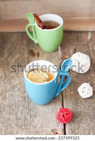 Mug of tea and orange on the table with christmas time decoration