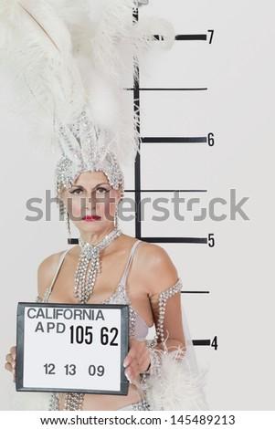 Mug shot of senior showgirl holding plaque