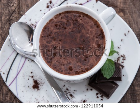 Mug with Hot Chocolate, pieces of Chocolate and Mint - stock photo
