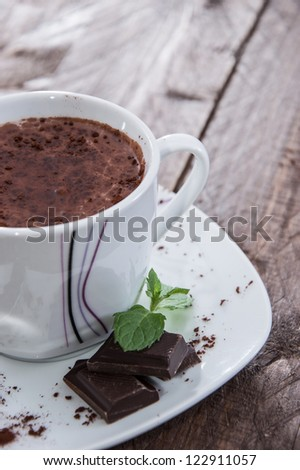Mug with Hot Chocolate, pieces of Chocolate and Mint