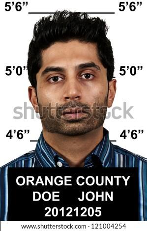 Mugshot of a handsome young man criminal