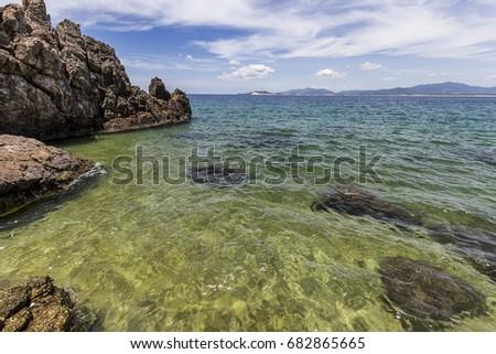 Mui Vi Rong beach Binh Dinh beach clear blue sky blue water with rocks