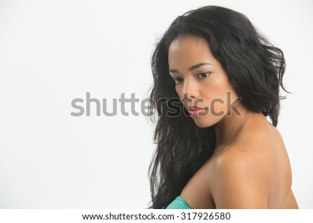 Mulatto profile  looking  down  showing her shoulder , neck and