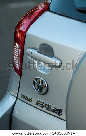 Mulhouse - France - 18 August 2019 - Closeup of logo, handle and rear light  on grey Toyota rav4 parked in the street #1481850914