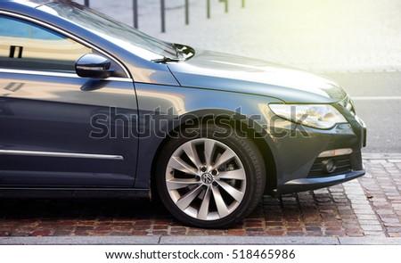 """MULHOUSE, FRANCE - DEC 19, 2015: Detail of Volkswagen Passat car parked in central city parking. The Volkswagen emissions scandal ( """"emissionsgate"""" or """"dieselgate"""") erupted on 18 September 2015 #518465986"""