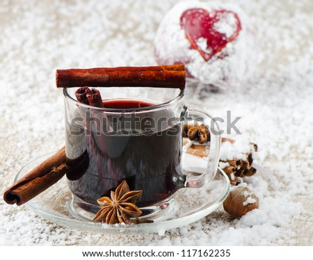 mulled wine and red apple   on a wooden table