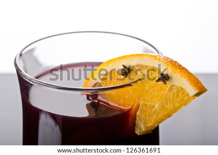 mulled wine drink with orange slice and cloves