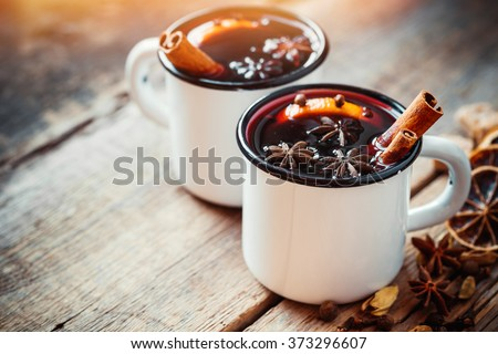 Mulled wine in white rustic mugs with spices and citrus fruit Stockfoto ©