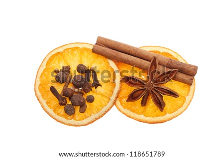 Mulled wine ingredients, dried orange, cinnamon, star anise and spices isolated against white - stock photo