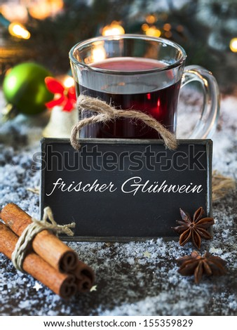 mulled wine with a tag and german text frischer gluhwein