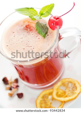 Mulled wine with cherry, slice of orange and spices