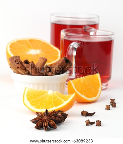 Mulled wine with oranges, cinnamon, anise and clove on white background