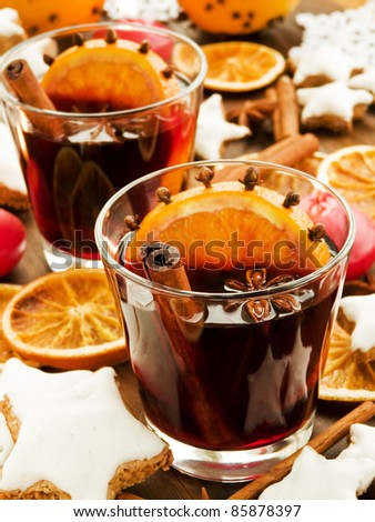 Mulled wine with spices and cinnamon cookies. Shallow dof.