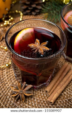 mulled wine with spices in glasses, top view, vertical