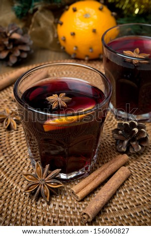 mulled wine with spices in glasses, vertical