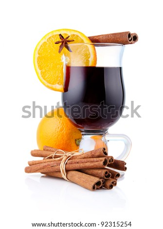 Mulled wine with spices isolated on white background