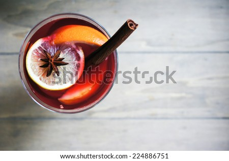 Mulled wine with spices on wooden background Сток-фото ©