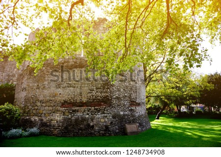 Multangular Tower in museum gardens,the best example of standing Roman remains in York, England under the sunshine and beautiful tree