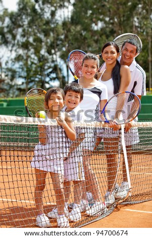 Multi-aged group of tennis players at the court