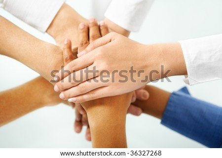 multi color hand of people hand in unity to express togetherness in community