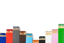 multi color matchboxes lined up like up and down grahpic on white with clipping path