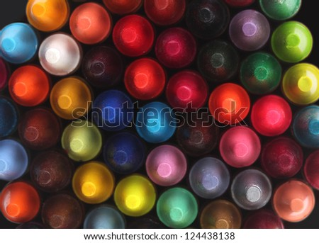 Multi color pastel(crayon) pencils for children(kids) used for drawing & coloring arranged attractively in rows and columns making a stunning display of colors