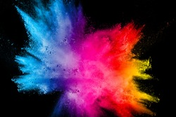 Multi color powder explosion isolated on black background.