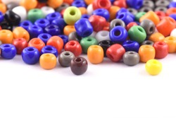 multi color spread on white background. Background or texture of beads. Close up, macro, make bead necklace or string of beads for women of fashion,Bead Crochet. Daily Beading.