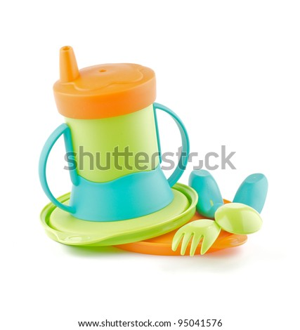 Multi-Colored Baby Bottle and Baby utensil isolated on white background