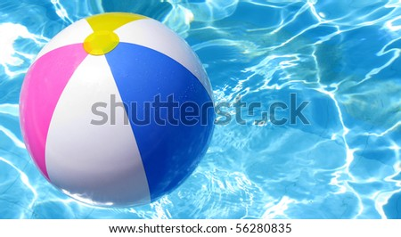 Multi colored Beach ball in swimming pool