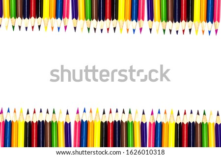 Multi-colored, bright sharpened pencils in different positions on a white background. Pencil sharpener. Pencil shavings.