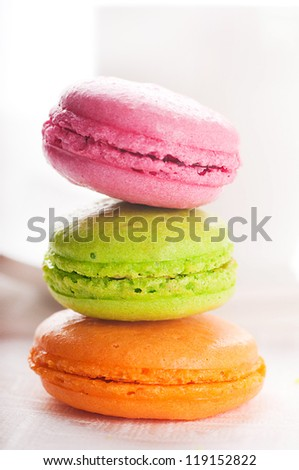 Multi-colored cakes and coffee on a white napkin