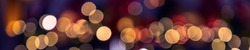 Multi-colored defocused background banner with lantern lights and garlands. Bokeh and blur effect. Defocused. Christmas, New year and other holliday mood.