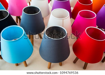 Multi colored lit lampshades in a store