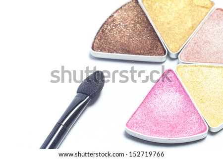 Multi colored make-up eye shadow and brush