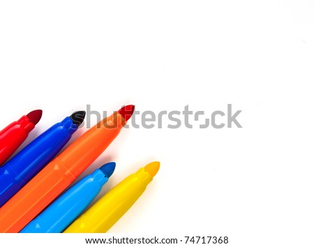 Multi-colored markers on white - stock photo