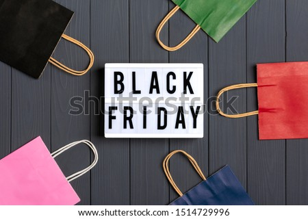 multi-colored packaging bags, gift boxes lightbox with text Black Friday on  dark gray background Top view Flat lay Autumn, october, november, sesonal sale, retail, shopping concept